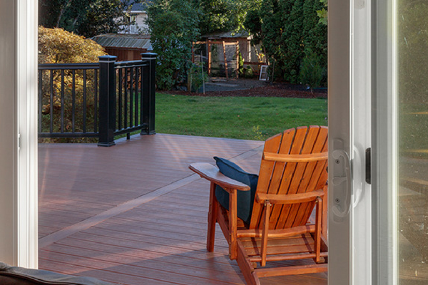 Timbertech Brown Decking with Black Railing Brown Chair with Pillow
