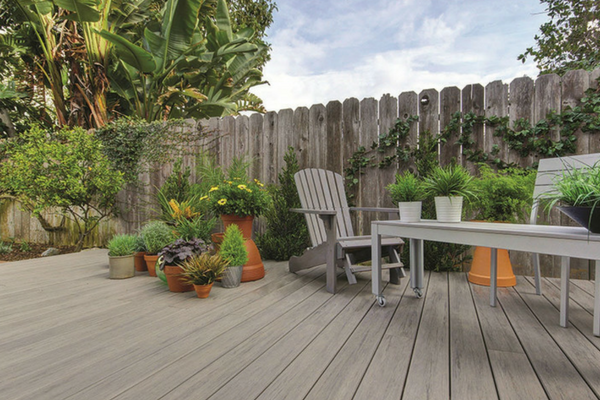 Timbertech Brown Decking With Plants and Chair